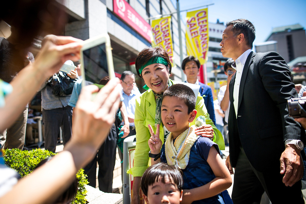 TOKYO, JAPAN - JULY 30 : Candidate Yuriko Koike a Liberal Democratic Party lawmaker and former defense minister takes photo with people a during the last day of Tokyo Gubernatorial Election campaign rally at Hachiōji Station, Tokyo, Japan on Saturday, July 30, 2016. Tokyo residents will vote on July 31 for a new Governor of Tokyo who will deal with issues related to the hosting of the Tokyo Summer Olympics and Paralympics in 2020. (Photo: Richard Atrero de Guzman/NUR Photo)