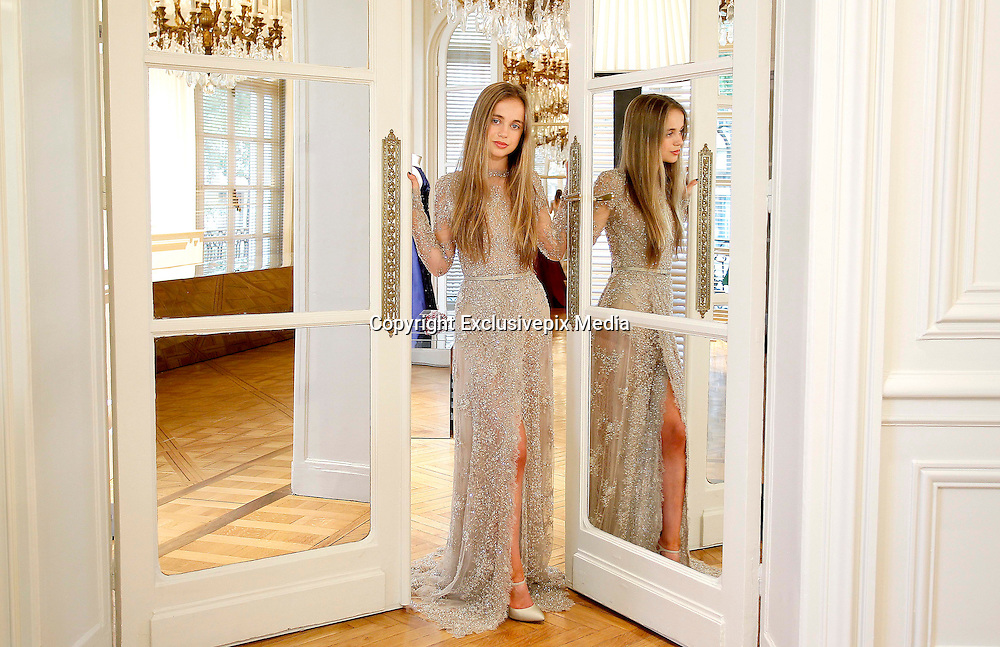 EXCLUSIVE LADY AMELIA WINDSOR- Backstage Le Bal - Raphael Palace in Paris <br /> A very beautiful (and rather naughty) Royal: Her extraordinary looks have landed her on the cover of Tatler. And Amelia Windsor's giving Harry a run for his money in the party stakes &nbsp;<br /> <br /> She dances on a yacht, lithe and bronzed in a neon bikini, her long hair gleaming in the sun. She's the picture of rebellion in a nightclub, sitting astride a female friend, her slim legs in revealing floral shorts and her midriff on show under her black crop top.<br /> And, again and again, pictures from her social media accounts show her pouting over cocktails and cigarettes.<br /> So far, so thrillingly wild. But it wasn't this side of Lady Amelia Windsor that was on show this week. On the cover of the latest edition of Tatler magazine, the granddaughter to the Queen's cousin, the Duke of Kent, is portrayed as more demure English rose than party girl. Indeed, the magazine even dubs her 'the most beautiful member of the Royal Family'.<br /> <br /> <br /> While you would be forgiven for not being instantly familiar with Lady Amelia, with her full lips, glossy mane and molten brown eyes, she's tipped as the one to watch among the young royals. And although the 20-year-old student may have a delicate baby-faced beauty, she's certainly not averse to living it up.<br /> Indeed, other pictures from her publicly available social media accounts show her dancing at Notting Hill Carnival (that bronzed midriff on display), posing at Glastonbury Festival and smoking in the bath. She's outspoken about her passion for Bloody Mary cocktails. And her apparent motto, as inscribed on a photo in her Instagram account? 'Go hard or go home.' In other words, party like you're Prince Harry.<br /> But Lady Amelia is no mere vacuous socialite in the making. On the contrary. She is vocal about her love for Latin, saying she is 'crazy' about it after studying it for A-level and is rather bookish in nature. She's