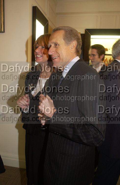Italian Ambassador Giancarlo Aragona and his wife Sandra aragona. Charles Finch and Dr. Franco Beretta host launch of Beretta stor at 36 St. James St. London. 10  January 2006. ONE TIME USE ONLY - DO NOT ARCHIVE  © Copyright Photograph by Dafydd Jones 66 Stockwell Park Rd. London SW9 0DA Tel 020 7733 0108 www.dafjones.com