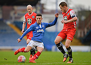 Portsmouths Conor Chaplin with a shot on goal blocked by Macclesfield Towns Paul Turnbull during the The FA Cup match between Portsmouth and Macclesfield Town at Fratton Park, Portsmouth, England on 7 November 2015. Photo by Adam Rivers.