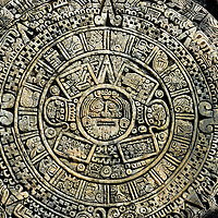 Aztec Sun Calendar in Tulum Pueblo, Mexico<br /> This is a sun calendar used by the Aztecs to measure days, months and cosmic cycles.  In the center is the face of Tonatiuh who was the mythological deity of the sun. This carving resembles one discovered in Mexico City in 1790. That major archeological find, which is named the &ldquo;Sun Stone,&rdquo; weighs 24 tons.