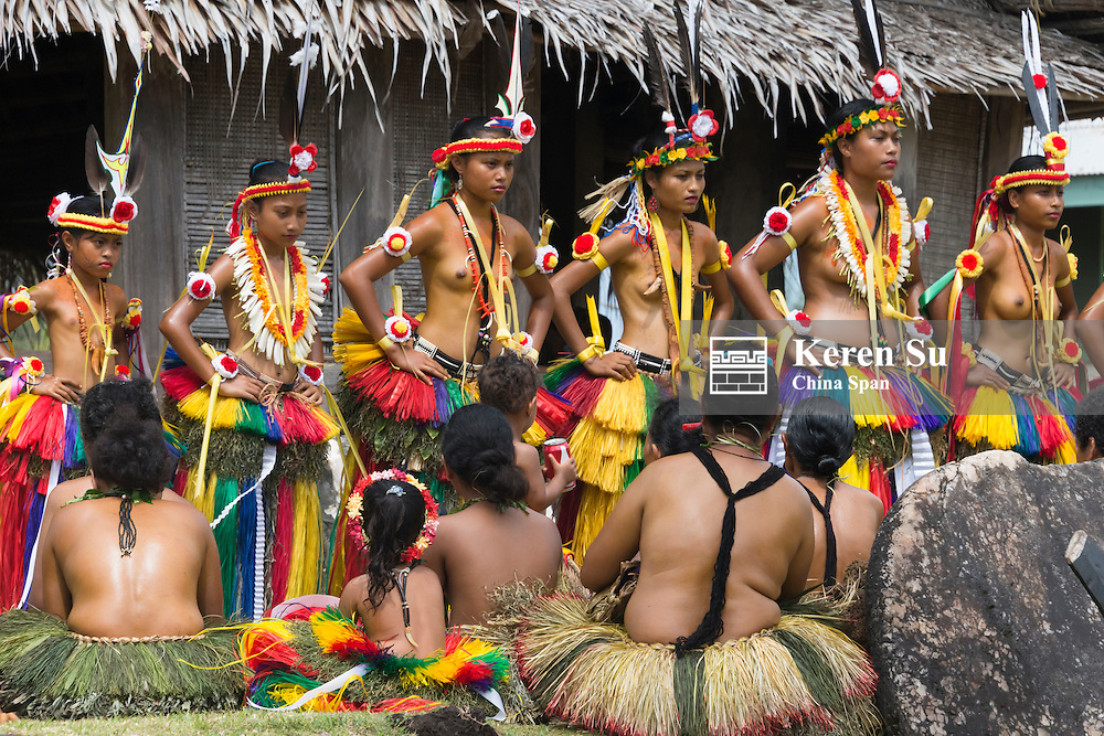 Yapese people watching girls performing at Yap Day Festival, Yap Island, Federated States of Micronesia