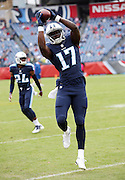 Tennessee Titans wide receiver Dorial Green-Beckham (17) jumps and catches a pass while warming up before the 2015 week 7 regular season NFL football game against the Atlanta Falcons on Sunday, Oct. 25, 2015 in Nashville, Tenn. The Falcons won the game 10-7. (©Paul Anthony Spinelli)