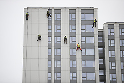 © Licensed to London News Pictures. 27/06/2017. London, UK. Specialists abseil on the face of Bray tower block to inspect cladding on the Chalcots Estate in Camden after it failed a fire inspection because of combustable cladding. More than 700 flats in tower blocks on an estate in the Swiss Cottage area of north-west London are being evacuated because of fire safety concerns after the Grenfell Tower fire of on June 14. Photo credit: Peter Macdiarmid/LNP