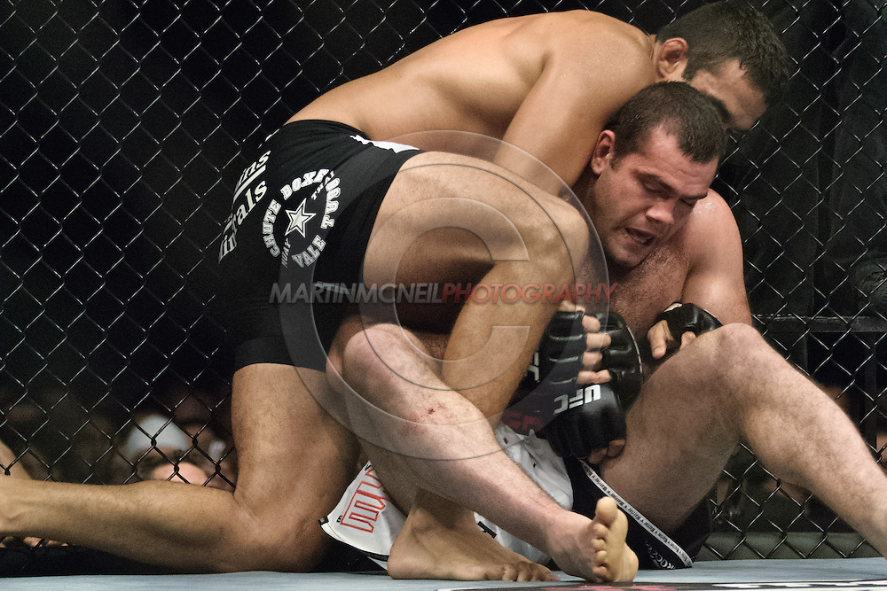 """NEWCASTLE, ENGLAND, UNITED KINGDOM, JANUARY 19 2008: Fabricio Werdum (top) muscles Gabriel Gonzaga down to the canvas during """"UFC 80: Rapid Fire"""" inside the Metro Radio Arena in Newcastle, England on January 19, 2008."""