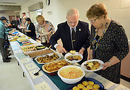 Barney Morris (2from right) and Marybeth Morris (right) of Levittown, Pennsylvania enjoy the international cuisine during the 15th annual international dinner Saturday October 17, 2015 at St. Elizabeth Ann Seton in Bensalem, Pennsylvania.  (Photo by William Thomas Cain)