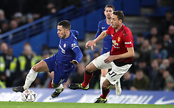 Chelsea's Eden Hazard (left) and Manchester United's Nemanja Matic battle for the ball during the FA Cup fifth round match at Stamford Bridge, London.