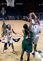 South Florida Bulls center Nalini Miller (32) blocks a Virginia Cavaliers Forward Lyndra Littles (1) shot.  The Virginia Cavaliers defeated the South Florida Bulls 73-71 in the third round of the Women's NIT held at John Paul Jones Arena in Charlottesville, VA on March 22, 2007.