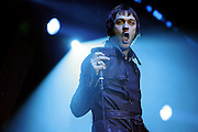 Tom Meighan of Kasabian performs live on stage at Earls Court on December 19, 2006 in London, England. (Photo by Simone Joyner)