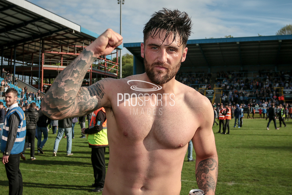Matthew Brown (Halifax) celebrates by punching the air following FC Halifax Town's promotion to the National League after the Vanarama National League North Play Off final match between FC Halifax Town and Chorley at the Shay, Halifax, United Kingdom on 13 May 2017. Photo by Mark P Doherty.