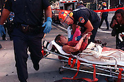 An EMT tends to a burn victim who escaped from the  World Trade Center Twin Towers prior to collapse after terrorist attacks in Manhattan, NY. 9/11/2001