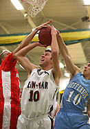 Assumption's Matt Vonderhaar (15) and Jefferson's Ky Kramer (10) try to block a shot by Linn-Mar's Matt Lassen (10) during the 2013 Eastern Iowa All-Star Basketball Game at Iowa City West High School in Iowa City on Wednesday, March 27, 2013. The South (dark) defeated the North (white) 87-79.
