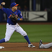 Wilmer Flores, New York Mets, turns a double play during the New York Mets Vs New York Yankees MLB regular season baseball game at Citi Field, Queens, New York. USA. 18th September 2015. Photo Tim Clayton