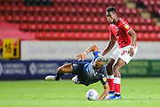 Nottingham Forest midfielder John Bostock (13) is fouled by Charlton Athletic midfielder Chuks Aneke (10) during the EFL Sky Bet Championship match between Charlton Athletic and Nottingham Forest at The Valley, London, England on 21 August 2019.