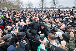 "© Licensed to London News Pictures . 18/03/2018 . London , UK . TOMMY ROBINSON (centre) delivers his speech to the crowd . 1000s including supports of alt-right groups such as Generation Identity and the Football Lads Alliance , at Speakers' Corner in Hyde Park where Tommy Robinson reads a speech by Generation Identity campaigner Martin Sellner . Along with Brittany Pettibone , Sellner was due to deliver the speech last week but the pair were arrested and detained by police when they arrived in the UK , forcing them to cancel an appearance at a UKIP "" Young Independence "" youth event , which in turn was reportedly cancelled amid security concerns . Photo credit: Joel Goodman/LNP"