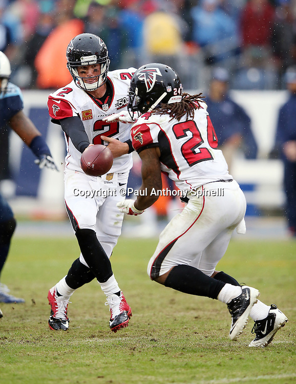 Atlanta Falcons quarterback Matt Ryan (2) hands off the ball to Atlanta Falcons running back Devonta Freeman (24) during the 2015 week 7 regular season NFL football game against the Tennessee Titans on Sunday, Oct. 25, 2015 in Nashville, Tenn. The Falcons won the game 10-7. (©Paul Anthony Spinelli)