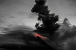 November 2, 2017 - Karo, North Sumatra, Indonesia - Sinabung volcano spews thick black smoke into the air seen in Karo, North Sumatra. Sinabung roared back to life in 2010 for the first time in 400 years. After another period of inactivity it erupted once more in 2013, and has remained highly active since. (Credit Image: © Ivan Damanik via ZUMA Wire)