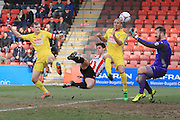 Dan Holman strikes the ball to score the opening goal during the Vanarama National League match between Cheltenham Town and Woking at Whaddon Road, Cheltenham, England on 12 March 2016. Photo by Antony Thompson.