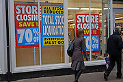 Woolworths shop with stock clearance closure sales notices, on Christmas Eve, Woodbridge, Suffolk, England