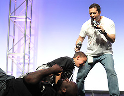 August 27, 2010; Boston, MA; USA; UFC's Mike Goldberg referees as Shaquille O'Neal is taken down by a youngster at the UFC 118 fanfest in Boston, MA.