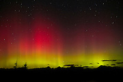 One of the largest solar flares on record caused this spectacular display of the northern lights (aurora borealis) over Three Fingers Mountain and other peaks in Washington's Central Cascades.