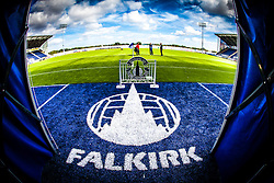 The new Falkirk sign on the blue part of the plastic pitch at the tunnell area, at Falkirk Stadium, with the new pitch, for the Scottish Championship game v Hamilton. The woven GreenFields MX synthetic turf and the surface has been specifically designed for football with 50mm tufts compared with the longer 65mm which has been used for mixed football and rugby uses.  It is fully FFA two star compliant and conforms to rules laid out by the SPL and SFL.<br />