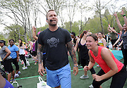"Bob Harper, trainer on ""The Biggest Loser,"" motivates the crowd while leading a body-blasting class at SELF magazine's 21st annual Workout in the Park, Saturday, May 10, 2014, in New York's Central Park.  (Photo by Diane Bondareff/Invision for SELF/AP Images)"