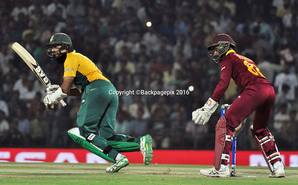 Hashim Amla of South Africa run out by Johnson Charles of West Indies  during the 2016 ICC World T20 cricket match between South Africa and West Indies at Vidharbha Cricket Association, Jamtha, India on 25 March 2016 ©BackpagePix