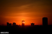 Sun rises over NC State and downtown Raleigh.