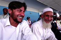 KABUL 25 August 2005..Mr Nasrullah Izmat, National Director of Special Olympics Afganistan, sits next to  Qari Gulbaz Khan - the old man who knows the Holy Koran by Heart...On 23-25 August 2005, Special Olympics Afghanistan held its first national Games at Olympic Stadium in Kabul. More than 300 athletes, including 80 female athletes, experienced a taste of happiness and achievement for the first time in their lives. They competed in athletics, bocce and football (soccer). Because of cultural restrictions, males and females competed at separate venues.