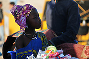 A young 'lady' sells charms and cigarettes in the desert venue of Timbuktu. Festival au Désert, 2011