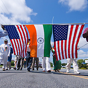 American and indian flag carriers carry both flags during Inaugural India Day Parade Saturday. August. 18, 2012. in Hockessin Delaware...Indian's around the world celebrates india's 65th anniversary of india's independence from British rule and the country's birth as a sovereign nation on August 15, 1947.