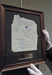 (c) London News Pictures. 06/12/2010. Pictured: The original handwritten lyrics of 'The Road To Hell' penned by Chris Rea is hung up at Bonhams Lyrics penned by famous songwriters including Sir Paul McCartney, Gary Barlow, Paul Weller and Annie Lennox go on display before the Bonhams' Entertainment Memorabilia Auction on the 15th December with proceeds going to the Teenage Cancer Trust. . Picture caption should read Will Oliver/London News Pictures.