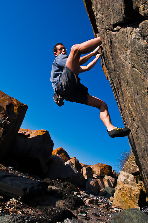 Stephane Lapierre, one of Quebec's climbing pionner, bouldering on the shore near its home at Metis-sur-Mer, Gaspesia.