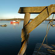 An old dock leads out over the water in Cundy's Harbor, Maine.