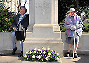 London News pictures. 08/03/11. 105-year-old former suffragette Hetty Bower (R) and her 79 year old daughter (L) at the statue of Emmeline Pankhurst to mark International Women's Day. She was  joined by Labour Leader Ed Miliband, Labour Deputy Leader Harriet Harman, and shadow home secretary Yvette Cooper. Emmeline  at the Pankhurst statue at Victoria Tower Gardens, Parliament Square, Westminster, London, Picture Credit should read Stephen Simpson/LNP
