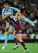 May 25th 2011: Darius Boyd of the Maroons tackles Mark Gasnier of the Blues during game 1 of the 2011 State of Origin series at Suncorp Stadium in Brisbane, Australia on May 25, 2011. Photo by Matt Roberts/mattrIMAGES.com.au / QRL