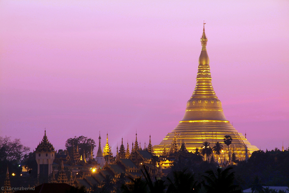 The Swedagon Paya is the most venerated and impressive Buddhist Stupa in Burma which enshrines strands of Buddha's hair and other holy relics. This shot was taken after sunset from a roof top in the Bahan area in Yangon, Myanmar. Photo by Lorenz Berna