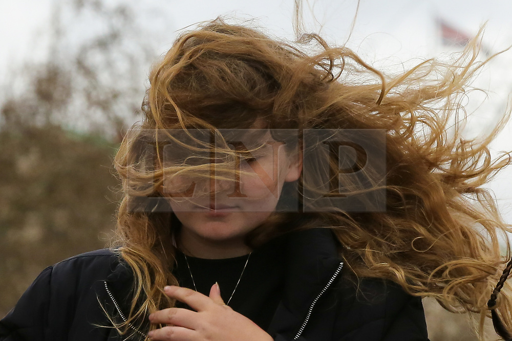 © Licensed to London News Pictures. 15/03/2019. London, UK. A woman's hair flies on a very windy day in London. Photo credit: Dinendra Haria/LNP
