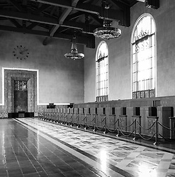 The original ticket lobby and its ticket counter of Union Station in Los Angeles. The train station is the largest passenger terminal in the Western United States, opened in 1939. Today is serves nearly 110,000 passengers a day with Amtrak long distance trains and local Metrolink commuter trains, subway and light rail.