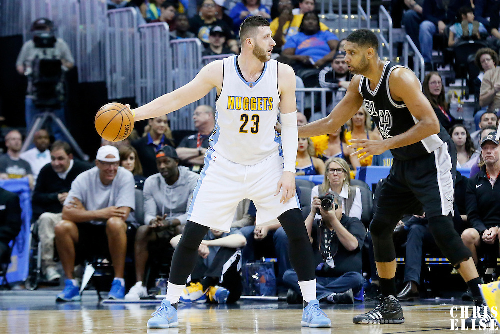 08 April 2016: San Antonio Spurs center Tim Duncan (21) defends on Denver Nuggets center Jusuf Nurkic (23) during the Denver Nuggets 102-98 victory over the San Antonio Spurs, at the Pepsi Center, Denver, Colorado, USA.