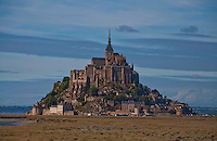 View across the marshes to the village and Abby of Mont St. Michel.