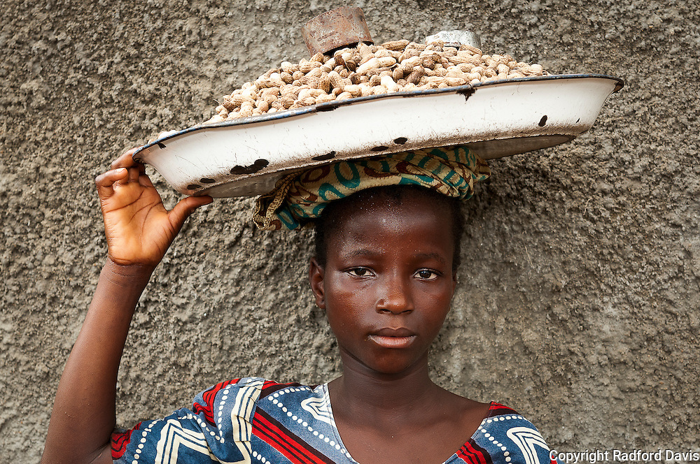 This girls sells peanuts to the gathering crowd watching the World Rabies Day parade. I stop and take her picture, paying her a few servings of nuts. After this, I'm her friend for the rest of the day.