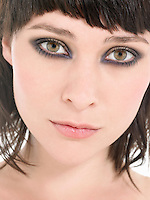 Young Woman Wearing heavy Eye Makeup portrait close up