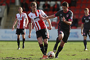 Kyle Storer and Peter Murphy during the EFL Sky Bet League 2 match between Cheltenham Town and Morecambe at Whaddon Road, Cheltenham, England on 1 April 2017. Photo by Antony Thompson.
