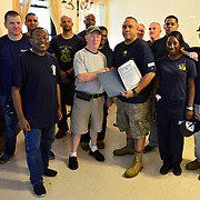 BRONX, NY - 8/18/2018 - <br /> U.S. Navy Chiefs from Navy Operational Support Center New York pose with legion member Bill Franklin after volunteering at Samuel H. Young American Legion Post 620 on Saturday.  (U.S. Navy Photo by Chief  Mass Communication Specialist Roger S. Duncan / RELEASED )