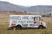 A sign is painted on a truck near the High Park fire has west of Fort Collins, Colorado June 18, 2012.  The fire has charred more than 85 square miles (200 square km) and sent a plume of smoke billowing thousands of feet into the air. REUTERS/Rick Wilking  (UNITED STATES)