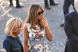 US First Lady Melania Trump (center) kisses French First Lady Brigitte Macron as they attend Bastille Day Military Parade, Place de la Concorde, in Paris on July 14, 2017. Photo by Ammar Abd Rabbo/ABACAPRESS.COM