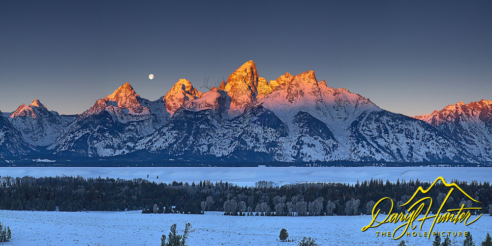 """A setting moon at sunrise in Grand Teton National Park<br /> <br /> For production prints or stock photos click the Purchase Print/License Photo Button in upper Right; for Fine Art """"Custom Prints"""" contact Daryl - 208-709-3250 or dh@greater-yellowstone.com"""