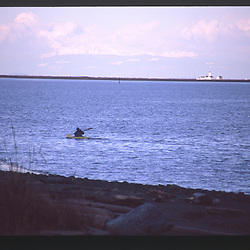 Kayak Takes to the Strait of Juan de Fuca with New Dungeness Lighthouse in the Distance, Dungeness Spit, Dungeness National Wildlife Refuge, Olympic Peninsula, Washington, US